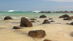 Big rocks on beautiful sandy beach in Sri Lanka stock footage