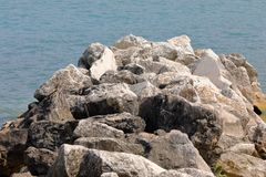 Big rocks. Form a cliff on the sea royalty free stock image