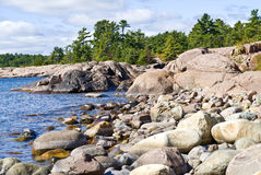 Big Rocks and Evergreen Trees Stock Images