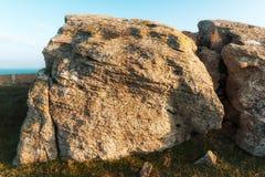 Big rocks. Foreland сoast in sunset rays Stock Image