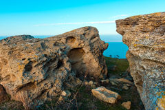 Big rocks. Foreland сoast in sunset rays stock photography