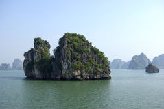 Big rocks in Halong bay. Lots of big rocks with vegetation in Halong bay in vietnam stock image