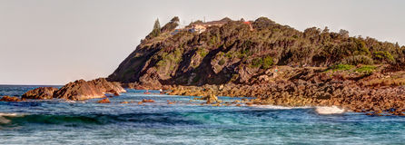 Big rocks and hill. S in pebbly beach , forster , nsw , Australia royalty free stock photos