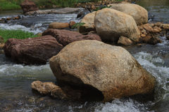 Big rocks in a rapid river Stock Photos