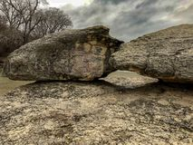 Big Rocks in the river. Big rocks in cold winter on a muddy river in Texas stock image
