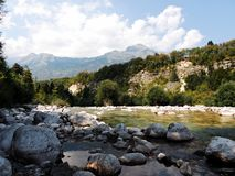 Big rocks by the river soča. In soča valley in slovenia royalty free stock images