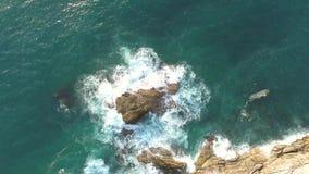 Big rocks in the sea against white ocean waves. Tropical 4K aerial view. stock video footage