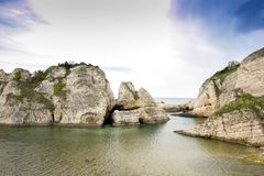 Big rocks in the sea. At cloudy day royalty free stock images
