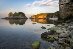 Big rocks in the sea. At sunset royalty free stock image