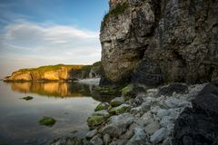 Big rocks in the sea. At sunset stock photos