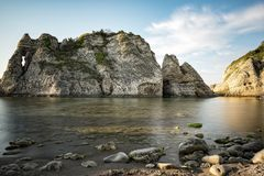 Big rocks in the sea. At sunset royalty free stock photography