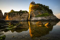Big rocks in the sea at sunset. With beautiful shadow royalty free stock images