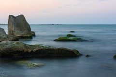 Big rocks on seashore Stock Images