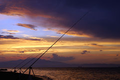 Big rods at sunset. With nice colorful clouds royalty free stock photography