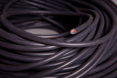 Roll of a black power cable Stock Images