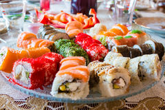Big roll set on a large plate at home Stock Image