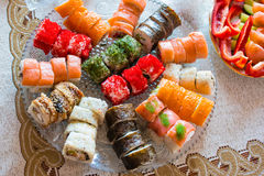 Big roll set on a large plate at home Royalty Free Stock Photography
