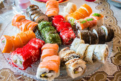 Big roll sushi set on a large plate at home. Royalty Free Stock Photography