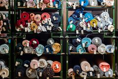 Free Big Rolls Of Colorful Fabric Stacked On Factory Shelves Ready For Production Stock Photography - 196389752