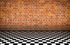 Big room. With brickwall, black and white floor royalty free stock images