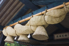 Big ropes hanging in front of shrine Royalty Free Stock Photo