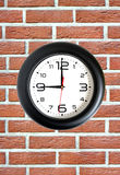 Big round clock on red brick wall closeup Royalty Free Stock Photography