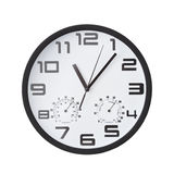 Big round clock on white wall. Royalty Free Stock Photos