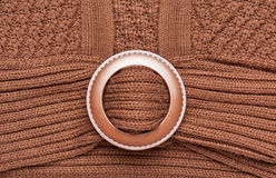 Big round fastener button on brown knitted wool pullover macro photo closeup as background Stock Images