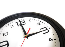 Big round wall clock isolated on whitey closeup Royalty Free Stock Images