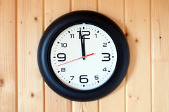 Big round wall clock isolated on wooden wall Stock Images