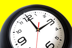 Big round wall clock isolated on yellow close-up Stock Image