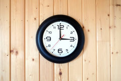 Big round wall clock on wooden background Stock Photography