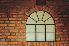 Free Big Rounded Window On Red Brick Wall Stock Photography - 91045182