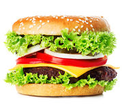 Big royal appetizing burger, hamburger, cheeseburger close-up isolated. On a white background Royalty Free Stock Photography