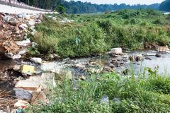 Big rubbish dump by the road and river royalty free stock image