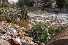 Big rubbish dump by the road at living area royalty free stock photo