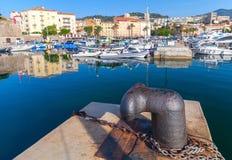 Big rusted mooring bollard in old port of Ajaccio Royalty Free Stock Photos