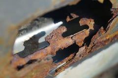 Big, rusty hole in the car door. On the sun Stock Photo