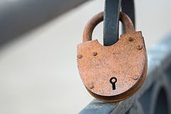 Big rusty padlock on fence Royalty Free Stock Photo