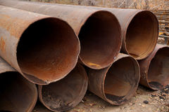 Big rusty pipes on construction object Stock Photography