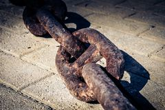 Big rusty steel chain on the ground stock photo