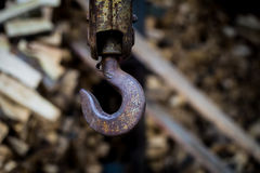 Big rusty steel hook weighs. On the background of wooden bars Royalty Free Stock Image