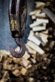Big rusty steel hook weighs. On the background of wooden bars Stock Photos