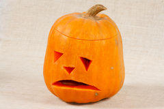 The big sad halloween pumpkin. On a canvas background Stock Image