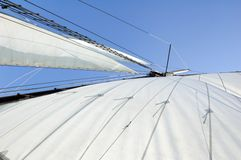 Big sail. On blue sky background Royalty Free Stock Images