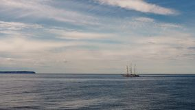 Big tall sailing boat at sea. Beautiful seascape in Baltic Sea in summer royalty free stock photo
