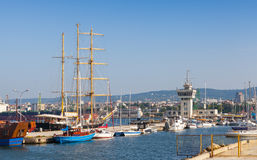 Big sailing ship and pleasure boats moored in Varna Port Royalty Free Stock Photos