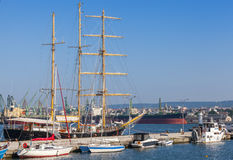 Big sailing ship and pleasure boats in port of Varna Royalty Free Stock Image