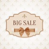Big sale banner with golden ribbon and a bow Stock Photography