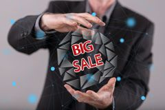 Concept of big sale. Big sale concept between hands of a man in background Royalty Free Stock Photo